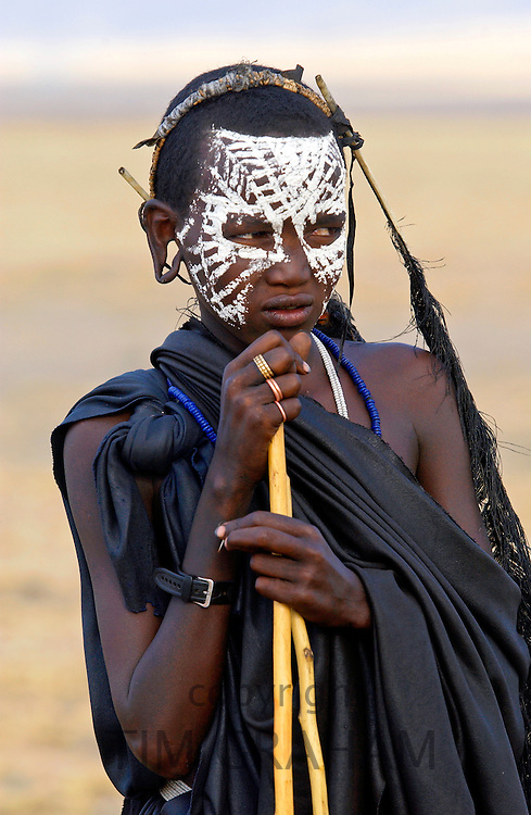 Young Masai Warrior with traditional face paint after 'coming of age'  in the Serengei Plains, Tanzania, East Africa
