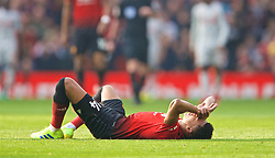 MANCHESTER, ENGLAND - Sunday, February 24, 2019: Manchester United's Jesse Lingard lies injured during the FA Premier League match between Manchester United FC and Liverpool FC at Old Trafford. (Pic by David Rawcliffe/Propaganda)