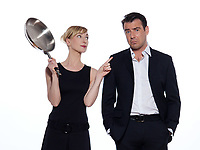 beautiful caucasian couple on studio white background in funny conflict