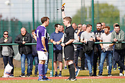 City of Liverpool's (purple) Matthew Williams gets the first yellow of the day during the North West Counties League Play Off Final match between Litherland REMYCA and City of Liverpool FC at Litherland Sports Park, Litherland, United Kingdom on 13 May 2017. Photo by Craig Galloway.