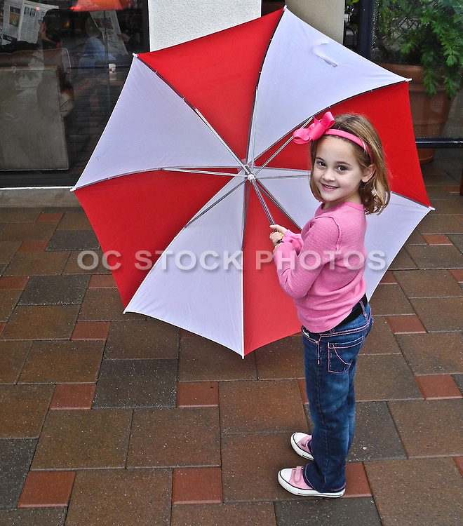 Young Girl With Umbrella In The Rain