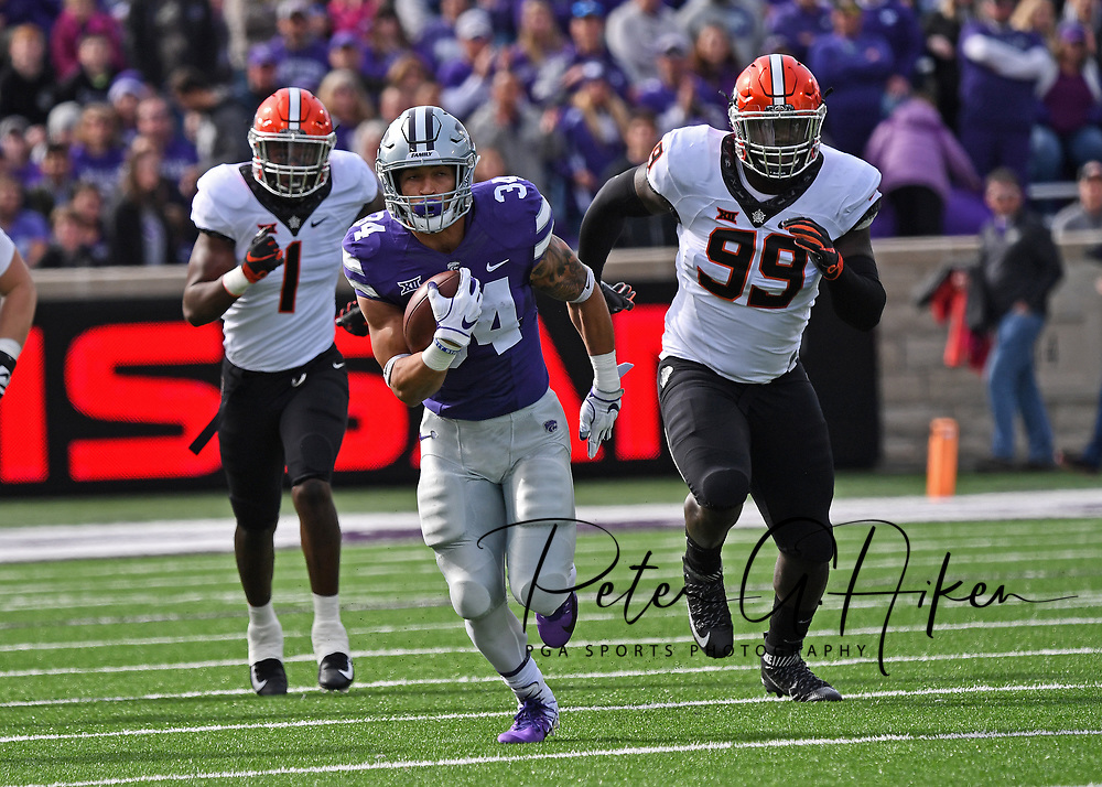 MANHATTAN, KS - OCTOBER 13:  Running back Alex Barnes #34 of the Kansas State Wildcats runs up field past defensive tackle Trey Carter #99 of the Oklahoma State Cowboys during the first half on October13, 2018 at Bill Snyder Family Stadium in Manhattan, Kansas.  (Photo by Peter G. Aiken/Getty Images) *** Local Caption *** Alex Barnes;Trey Carter