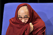 His Holiness the Dalai Lama wraps himself in his robe before speaking at a media briefing in Sydney, Australia.