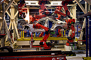 CASSINO, ITALY - NOVEMBER 24: A robot moves in the Body Shop where they assemble the Alfa Romeo Giulia and Stelvio in the Cassino Assembly Plant FCA Group. This is the most highly-automated area of the plant with nearly 1300 robots installed on  November 24, 2016 in Cassino, Italy.