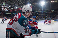 KELOWNA, CANADA - FEBRUARY 17: Brett Kemp #24 of the Edmonton Oil Kings skates to check Leif Mattson #28 of the Kelowna Rockets in the corner during first period  on February 17, 2018 at Prospera Place in Kelowna, British Columbia, Canada.  (Photo by Marissa Baecker/Shoot the Breeze)  *** Local Caption ***