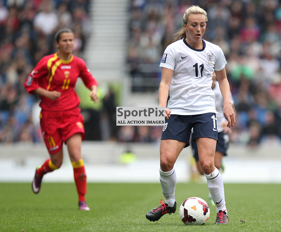 England's Toni Duggan with the ball during the FIFA Women's World Cup qualifier match between England and Montenegro at the American Express Community Stadium, Brighton, 5th April 2014 © Phil Duncan | SportPix.org.uk