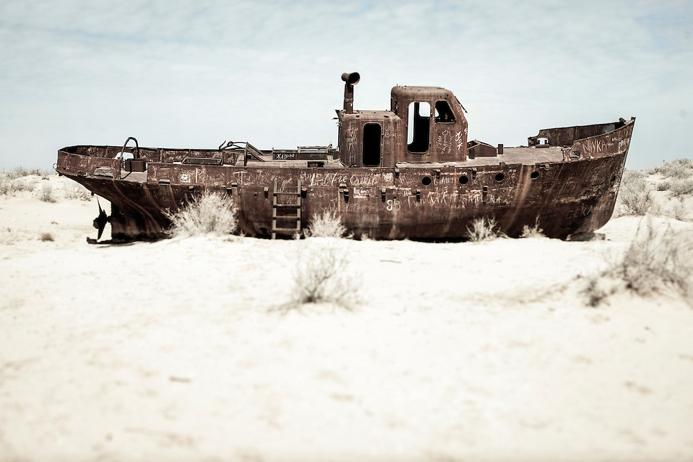 Moynaq, Uzbekistan 29 March 2012<br /> View of the the boat cemetery in the Aral sea.<br /> The Aral sea was a lake that lay between Kazakhstan in the north and Karakalpakstan, an autonomous region of Uzbekistan, in the south. <br /> The name roughly translates as &quot;Sea of Islands&quot;, referring to more than 1,534 islands that once dotted its waters.<br /> Formerly one of the four largest lakes in the world with an area of 68,000 square kilometres, the Aral Sea has been steadily shrinking since the 1960s after the rivers that fed it were diverted by Soviet irrigation projects. By 2007, it had declined to 10% of its original size.<br /> PHOTO: EZEQUIEL SCAGNETTI