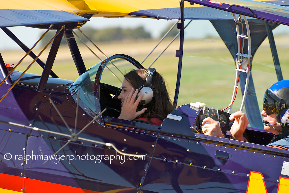 Hillary Swindell prepares for a biplane test ride at the 8th Annual 2007 Moonlight Fund airshow in New Braunfels, Texas. Hillary is the daughter of Moonlight Fund cofounder Celia Jones. The Moonlight