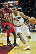 March 23, 2010; Cleveland, OH, USA; Cleveland Cavaliers point guard Ramon Sessions (3) drives past New Jersey Nets small forward Travis Outlaw (21) during the fourth quarter at Quicken Loans Arena. The Nets beat the Cavaliers 98-94 in overtime. Mandatory Credit: Jason Miller-US PRESSWIRE