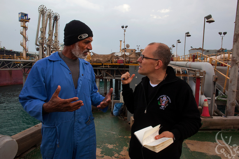 Der Spiegel correspondent Bernhard Zand (r) interviews Iraqi Southern Oil Company worker Abu Mohammed at the Al Basrah Oil Terminal (ABOT) February 2, 2010 some 50 kilometers off the coast of Iraq. The terminal is a vital part of Iraqs oil infrastructure with more than 90 percent of the country's oil exports pass through this terminal yearly. Abu Mohammed is 62 years old and has worked at the platform for 35 years. (Photo by Scott Nelson/Agentur Focus)