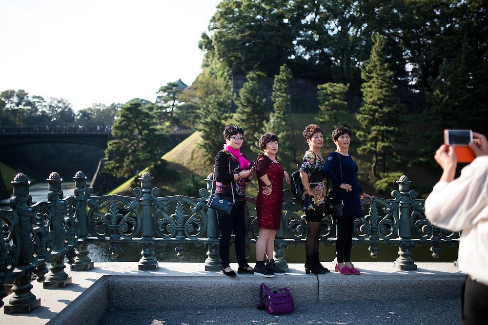 TOKYO, JAPAN - OCTOBER 19 : Chinese tourist taking photos in Tokyo Imperial Palace on October 19, 2015 in Tokyo, Japan. <br /> <br /> Photo: Richard Atrero de Guzman