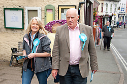 © Licensed to London News Pictures. 20/07/2019. Builth Wells, Powys, Wales, UK. Des Parkinson and supporter in Builth Wells High Street.  The Brexit Party, with  Brecon & Radnorshire constituency candidate Des Parkinson,  bring their campaign to the small Welsh market town of Builth Wells in Powys, UK. in a bid to win a seat in the forthcoming Brecon & Radnorshire constituency by-election on the 1st August 2019. The Brexit Party was founded by former UKIP economics spokeswoman, Catherine Blaiklock in January 2019, and is led by Nigel Farage. The Brexit party has 29 Members of the European Parliament (MEPs) and four Welsh Assembly Members. The party's first major electoral success was winning the 2019 European Parliament election in the United Kingdom after four months in existence. Photo credit: Graham M. Lawrence/LNP