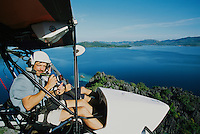 Photographer Tim Laman shooting from an ultralight.
