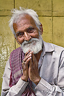 Indian man among the gullies of Delhi, India