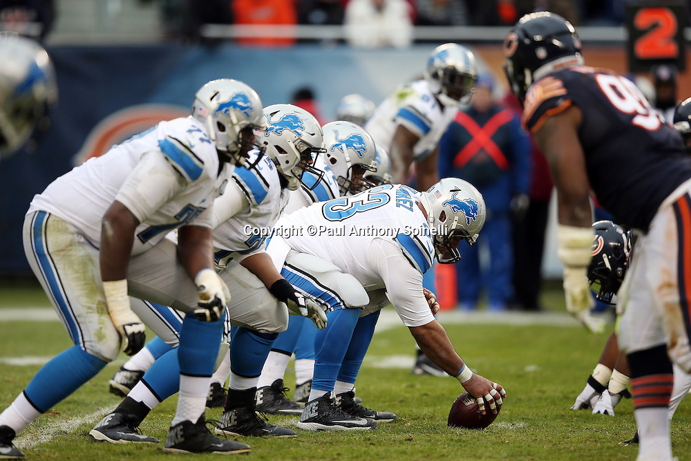 The Detroit Lions offensive line gets set at the line of scrimmage opposite the Chicago Bears defensive line during the NFL week 17 regular season football game against the Chicago Bears on Sunday, Jan. 3, 2016 in Chicago. The Lions won the game 24-20. (©Paul Anthony Spinelli)