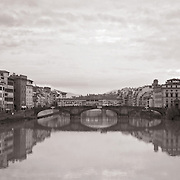 Santa Trinita and Ponte Vecchio reflecting in the Arno river- Florence, Italy.