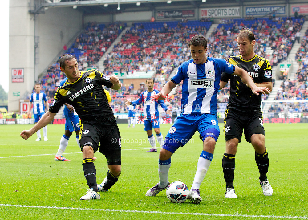 WIGAN, ENGLAND - Sunday, August 19, 2012: Chelsea's Frank Lampard and Branislav Ivanovic in action against Wigan Athletic's Franco Di Santo during the Premiership match at the DW Stadium. (Pic by Vegard Grott/Propaganda)