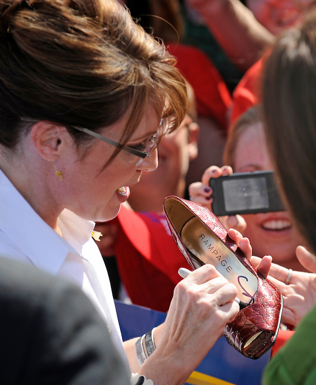 Republican Vice Presidential Candidate and Alaska Governor Sarah Palin signs a woman's shoe at a rally at the Richmond International Raceway in Richmond, Virginia USA, on 13 October 2008. Palin and her running mate Senator John McCain are behind in many national voter polls.