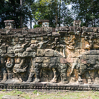 The Terrace of the Elephants is part of the walled city of Angkor Thom.  Which is a ruined temple complex in Cambodia.  The terrace was used by Angkor's king Jayavarman VII as a platform to view his victorious returning army.
