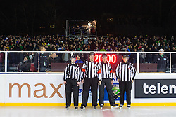 Referees Ales Fajdiga and Borut Lesnjak and linesmans during ice hockey match between HDD Telemach Olimpija and HDD SIJ Acroni Jesenice at Winter Classic of HDD Telemach Olimpija called Pivovarna Union Ice Fest 2014, on December 18, 2014 on Republic Square, Ljubljana, Slovenia. (Photo By Matic Klansek Velej / Sportida.com)