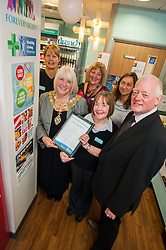 Lloyds Pharmacy Stocksbridge has achieved the status of 'Healthy Living Pharmacy'. A special accreditation for offering high levels of health screening  and advice to the local community. Pharmacy Manager Jackie Walter receiving the award from Mayor of Stocksbridge Susie Abrahams, also pictured left to right are Lloyds Stocksbridge Healthy Living Champion Vikki Sheppard, Valley Medical Centre Practace Manager Liz Sedgwick, Pharmacy Develpment Manager NHS Sheffield Jo Tsoneva and NHS Sheffield Commissioning Manager Gareth Johnstone,....04 October 2012.Image © Paul David Drabble
