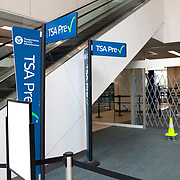 The TSA Precheck line at Orlando International Airport is empty to air passengers due to the Coronavirus (Covid-19) outbreak on Friday, April 17, 2020 in Orlando, Florida. (Alex Menendez via AP)