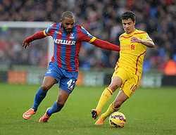 Liverpool's Philippe Coutinho battles for the ball with Crystal Palace's Jason Puncheon - Photo mandatory by-line: Alex James/JMP - Mobile: 07966 386802 - 23/11/2014 - Sport - Football - London -  - Crystal palace  v Liverpool - Barclays Premier League
