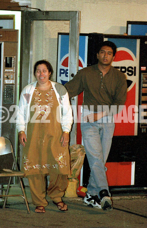 An unidentified woman, and man leave the Xtra gas station in Laurel Springs, NJ. early Thursday morning (1:45AM) after talking with police. From what I learned at the scene, they are family members of the murder victim. I was told by an official, that the woman is the victim's wife. (I COULD NOT CONFIRM THAT FACT)