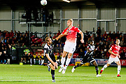 Salford City midfielder Tom Walker head the ball during the EFL Sky Bet League 2 match between Salford City and Grimsby Town FC at Moor Lane, Salford, United Kingdom on 17 September 2019.