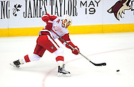 Apr 23, 2010; Glendale, AZ, USA; Detroit Red Wings center Kris Draper (33) shoots the puck during the first period of game five in the first round of the 2010 Stanley Cup Playoffs at Jobing.com Arena.  The Red Wings defeated the Coyotes 4-1.  Mandatory Credit: Jennifer Stewart-US PRESSWIRE