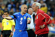 A frustrated Italian coach Marcello Lippi discusses tactics with Fabio Cannavaro during the 2010 FIFA World Cup South Africa Group F match between Italy and New Zealand at the Mbombela Stadium on June 20, 2010 in Nelspruit, South A
