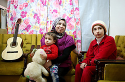 Syrian refugee Hanin Bathish Mtaweh, 13, with her mother Ibtissam, 43, and two-year old sister Amar in the basement of a former ski chalet block where they live in Mount Lebanon, just north of the Lebanese capital, after the family fled Syria five years ago.