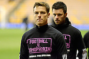 Scott Parker warms up wearing Football v Homophobia shirt during the Sky Bet Championship match between Wolverhampton Wanderers and Fulham at Molineux, Wolverhampton, England on 24 February 2015. Photo by Alan Franklin.