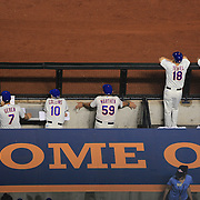 New York Mets coaching staff watch the game from the dugout, left to right, Bob Geren, Bench Coach, Terry Collins, Manager, Dan Warthen, Pitching Coach, Tim Teufel, Third Base Coach and Tom Goodwin, First Base Coach during the New York Mets V Arizona Diamondbacks Major League Baseball game  at Citi Field, Queens, New York. USA. 3rd July 2013. Photo Tim Clayton