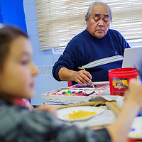 050114       Cable Hoover<br /> <br /> Artist and illustrator Irving Toddy sits among Gallup Catholic School students and works on his paintings during an art workshop Thursday.