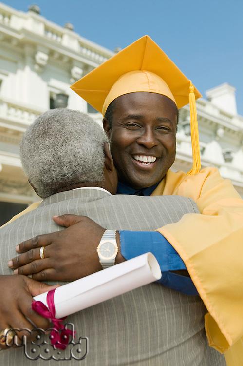 Graduate Hugging Father