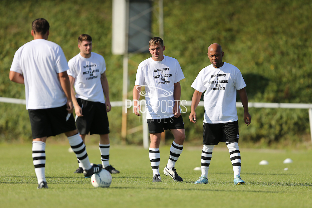East Preston players wraming up in tribute shirts during the FA Vase 1st Qualifying Round match between Worthing United and East Preston FC at the Robert Eaton Memorial Ground, Worthing, United Kingdom on 6 September 2015. The first home match for Worthing United since losing team mates Matthew Grimstone and Jacob Schilt in the Shoreham air show disaster.