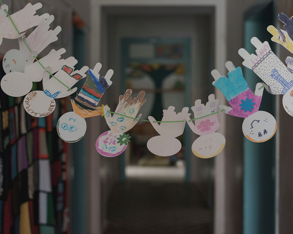 A paper chain drawn by children, hangs in a corridor in Villa Artemis, a shelter for 30 refugee women and their children in the grounds of Leros Hospital. <br />
