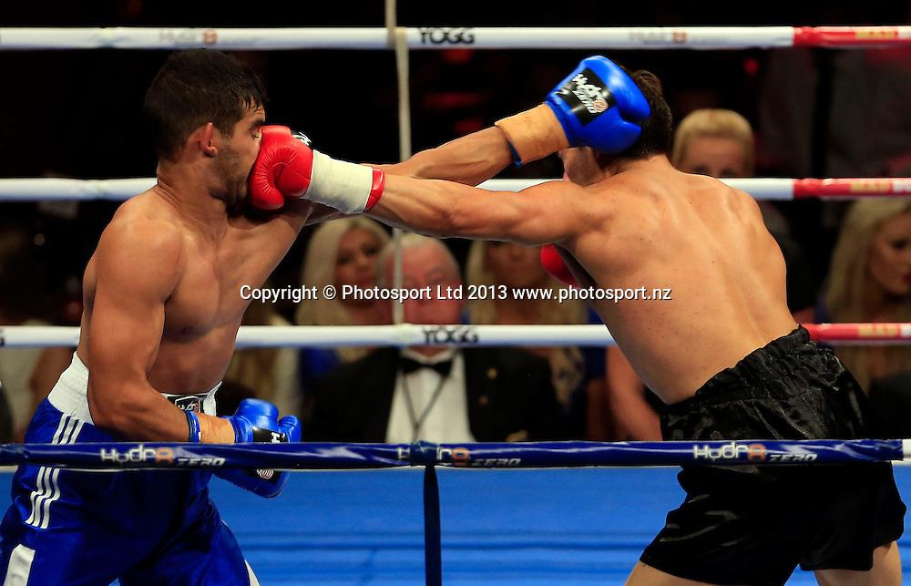 Jeremy Sebastian (left) and Marcel Botha fight. Boxing, Hyrd8 Zero Explosion, Fight Night, Trusts Arena, Auckland, Thursday 13th June 2013. Photo: Shane Wenzlick / Photosport.co.nz