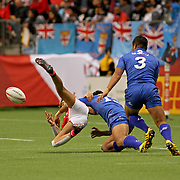 Manu Samoa's tough defense when needed, proved the deciding factor giving Samoa a 26-21 victory over France in the Canada 7's Trophy Quarter Final at BC Place, Vancouver, Canada.  Photo by Barry Markowitz, 3/12/17