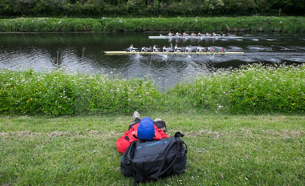 &copy; Licensed to London News Pictures.13/06/15<br /> Durham, England<br /> <br /> A man relaxes on the grass and watches the rowing during the 182nd Durham Regatta rowing event held on the River Wear. The origins of the regatta date back  to commemorations marking victory at the Battle of Waterloo in 1815. This is the second oldest event of this type in the country and attracts over 2000 competitors from across the country.<br /> <br /> Photo credit : Ian Forsyth/LNP