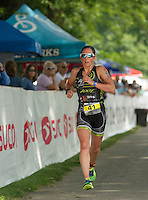 Pro athlete Amber Ferreira of Concord, NH heads out on the 13 mile run course during Sunday's Ironman 70.3 Timberman Triathlon at Ellacoya State Beach.  (Karen Bobotas/for the Laconia Daily Sun)