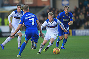 David Perkins brings the ball forward during the EFL Sky Bet League 1 match between AFC Wimbledon and Rochdale at the Cherry Red Records Stadium, Kingston, England on 8 December 2018.