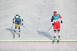 PYEONGCHANG, Feb. 15, 2018  Marit Bjoergen (R) from Norway crosses finishing line of women's 10KM free event of country skiing at Pyeongchang 2018 Winter Olympic Games at Alpensia Cross-Country Centre, PyeongChang, South Korea, Feb. 15, 2018. Marit Bjoergen claimed third place in a time of 25:32.4. (Credit Image: © Bai Xuefei/Xinhua via ZUMA Wire)