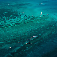 Alligator Lighthouse and snorkle boats over coral reefs, Florida Keys.