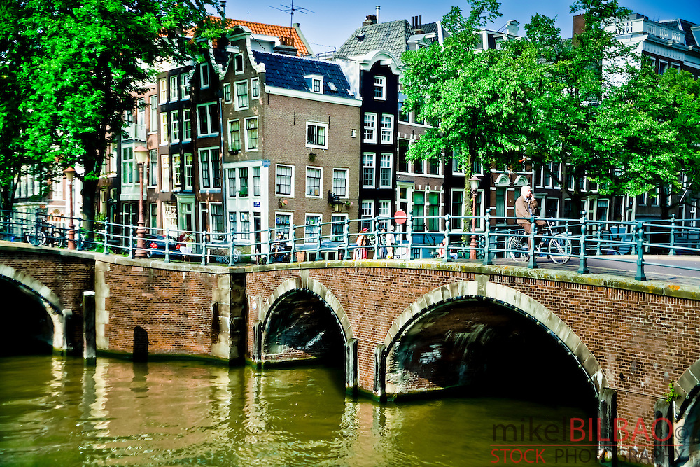 Street and canal.<br /> Amsterdam,Holland, Netherlands, Europe