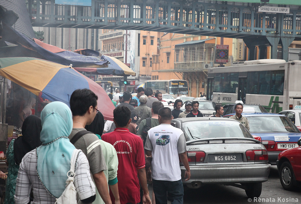Streets in the capital Kuala Lumpur fill with people and cars during rush hour. It is the largest and fastest growing city in Malaysia.