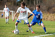 CVU's Dillon Hamrell (1) gets past Mt. Anthony's William Shea (12) with the ball during the boys semifinal soccer game between Mount Anthony and Champlain Valley Union at CVU high school on Tuesday afternoon October 27, 2015 in Hinesburg. (BRIAN JENKINS/ for the FREE PRESS)