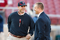 November 6, 2010; Stanford, CA, USA;  Stanford Cardinal head coach Jim Harbaugh (left) talks with ESPN commentator Kirk Herbstreit before the game against the Arizona Wildcats at Stanford Stadium. Stanford defeated Arizona 42-17.