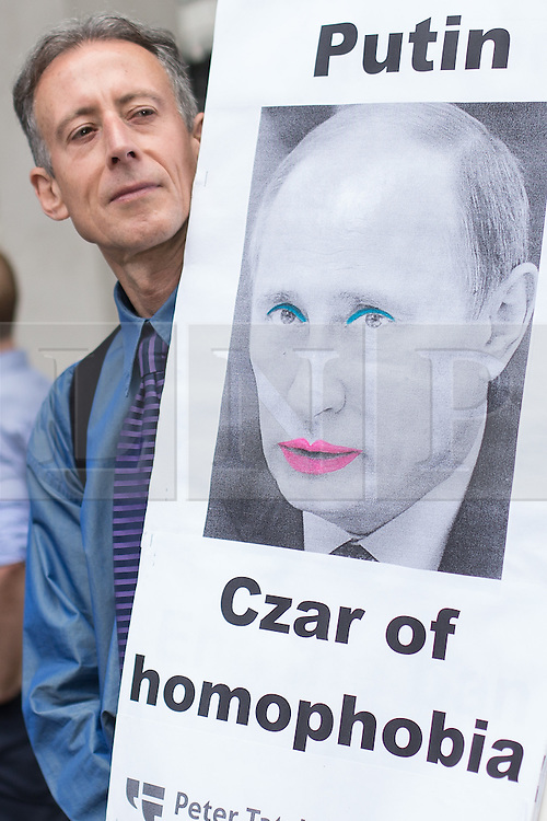 "© Licensed to London News Pictures . 10/08/2013 . London , UK . Human rights campaigner , PETER TATCHELL with an anti Putin banner . Demonstration against homophobic laws being enacted in Russia on Whitehall this afternoon (10th August 2013) . Legislation includes banning gay pride events for100 years , banning the distribution of "" propaganda of non-traditional sexual relations "" to minors , making it illegal for the adoption of Russian children by gay couples or any single person who comes from a country that recognises marriage equality and giving authorities the rights to arrest foreign nationals whom they suspect are LGBT or pro gay with the right to detain them for up to 14 days. Photo credit : Joel Goodman/LNP"